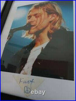 Framed photo and paper signed by Nirvana Kurt Cobain