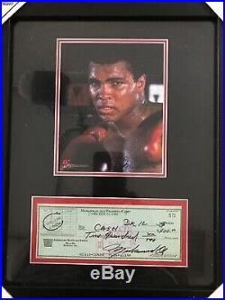 Muhammad Ali signed 16x14 Frame With The Check (Not authentic)